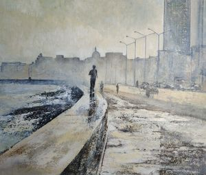 Young man running down the Malecón - tomascastano