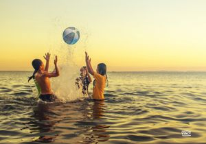 Kids playing with beach ball