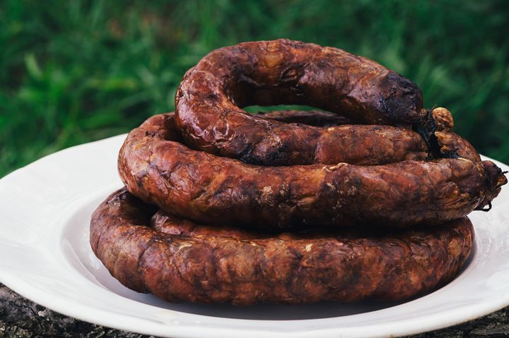 Grilled sausage in a white bowl onwo - The most