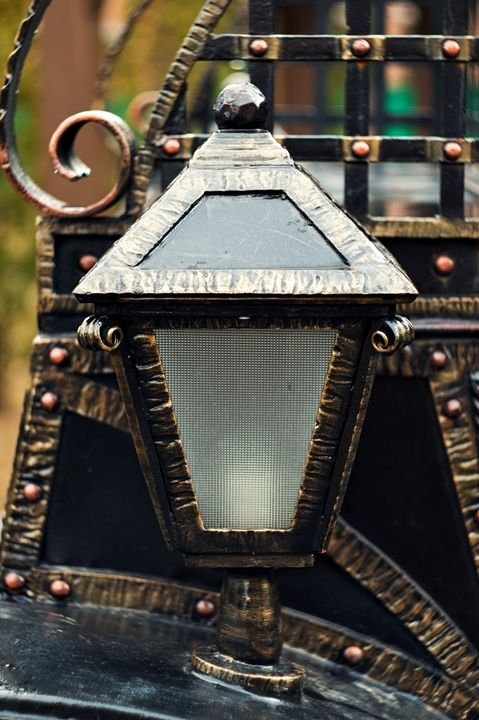 Antique lantern on a brick wall Forg - The most