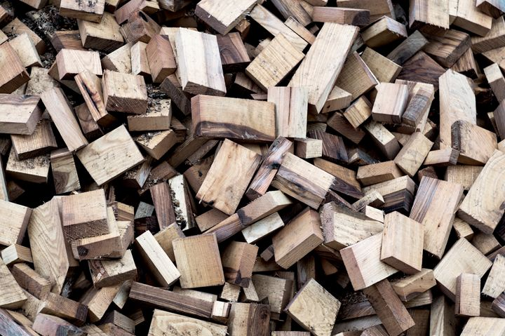 Chopped firewood dumped on a pile of - The most