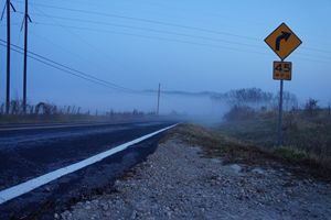 Country road under morning fog