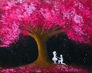 Romantic couple under cherry blossom