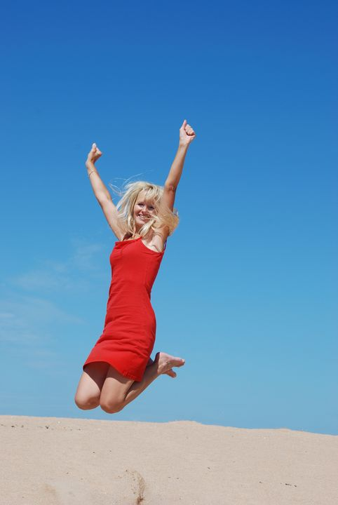 woman Jumping on beach - Heliosphile