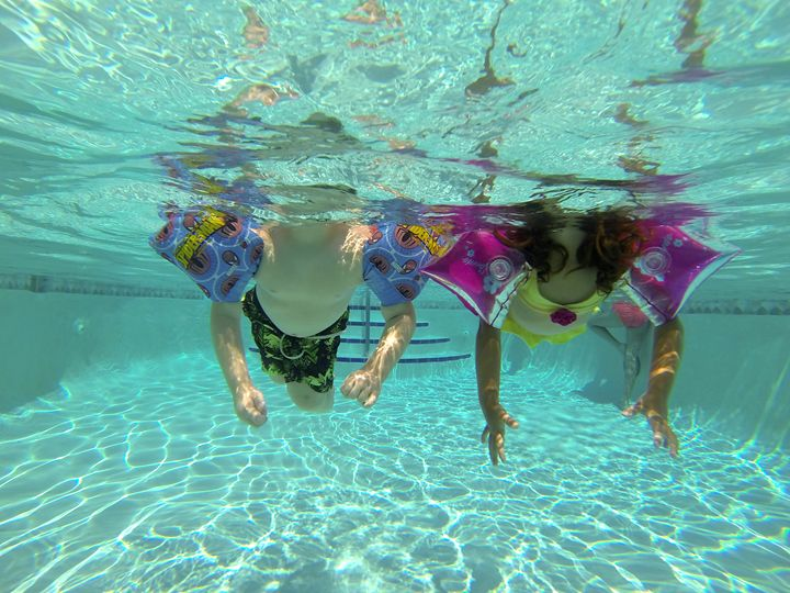 two children swimming - Kcable
