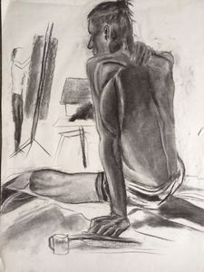Seated nude man facing painter