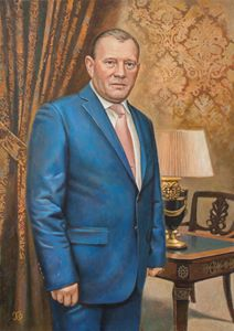 Portrait of the man in blue suit