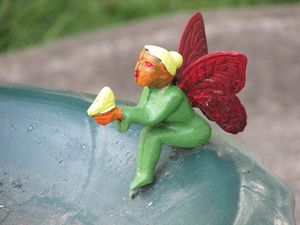 Fairy sitting on a bird bath
