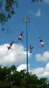 Clowns flying in the sky at Tulum