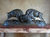 two bison fighting bronze