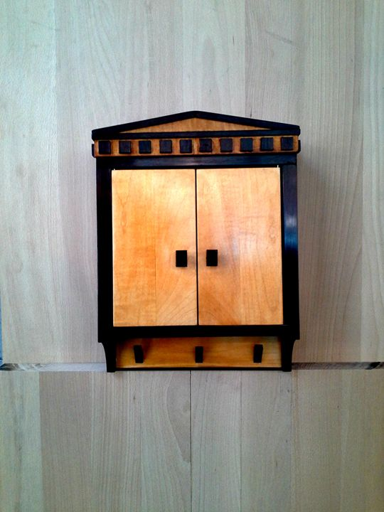 small cabinet with hangers -  Heptatrine