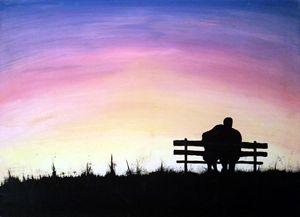 Couple watching morning sunrise