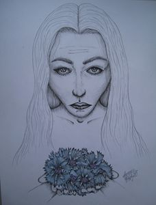 A girl with cornflowers
