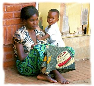 African Mother and Child by Wall - African Art Images