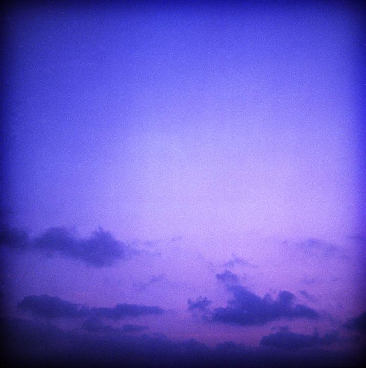 Clouds in sky in blue purple dusk - edwardolive