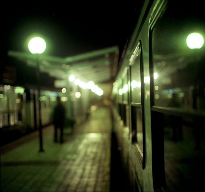 Old train at night in empty station - edwardolive