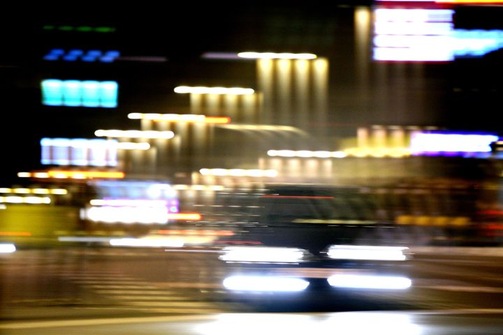 Car in street in urban city lights - edwardolive
