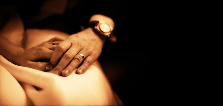 Bride and groom holding hands sepia - edwardolive