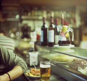 Man tapas and glass of beer