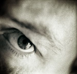 Closeup of eye of man black white