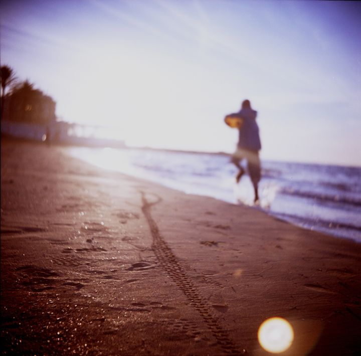 Boy running on beach square Lubitel - edwardolive