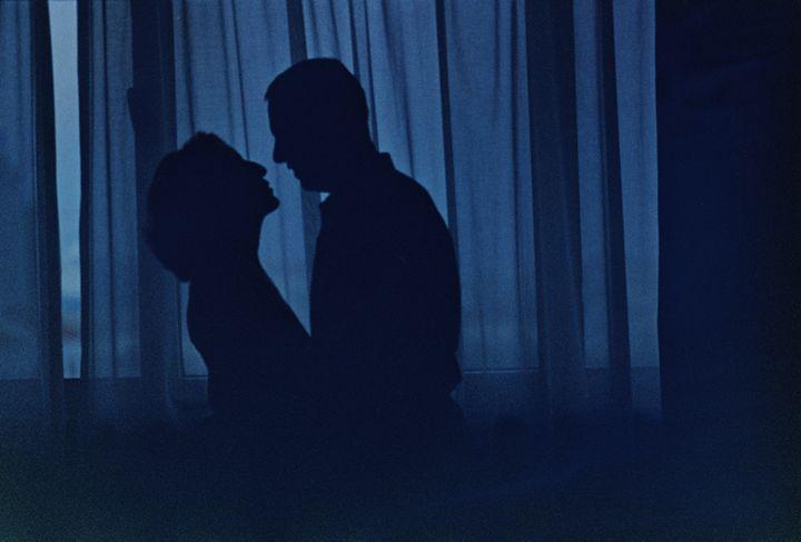 Blue silhouette couple kissing photo - edwardolive