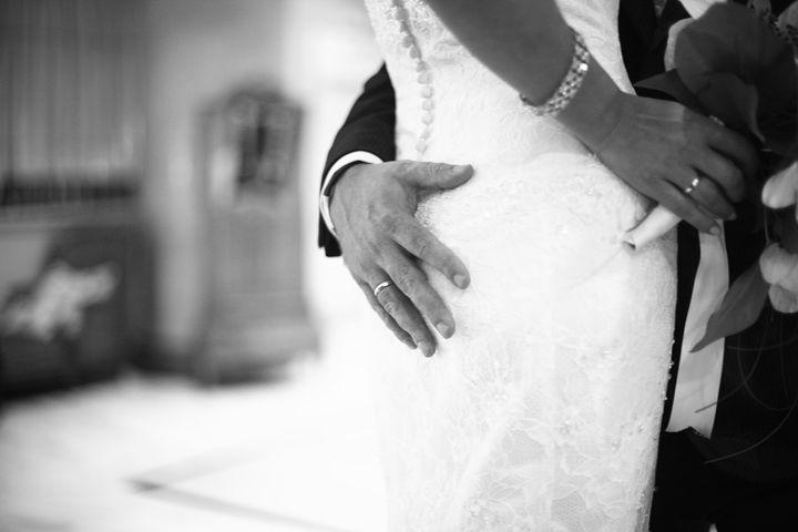 Groom holding bottom of bride - edwardolive