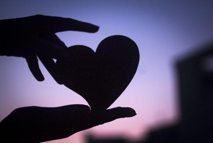 Love heart shape in hands photograph - edwardolive