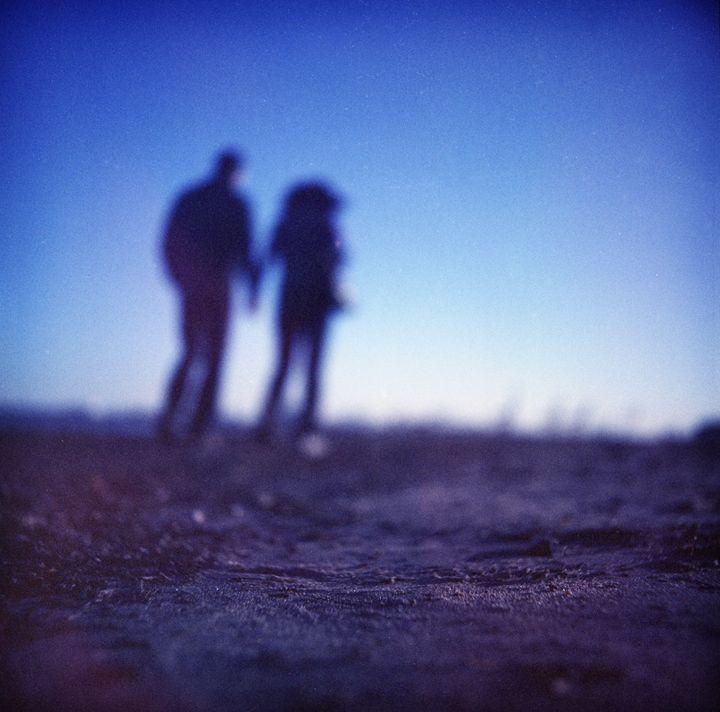 Romantic couple holding hands - edwardolive