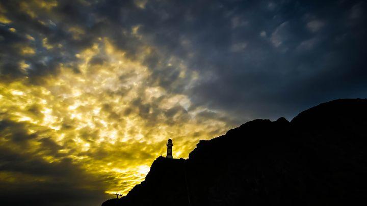 Lighthouse sunset - teodoramotateanu