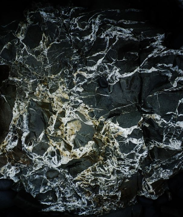 BLACK ROCK MARBLED WITH WHITE QUARTZ - Richard Brookes Photography