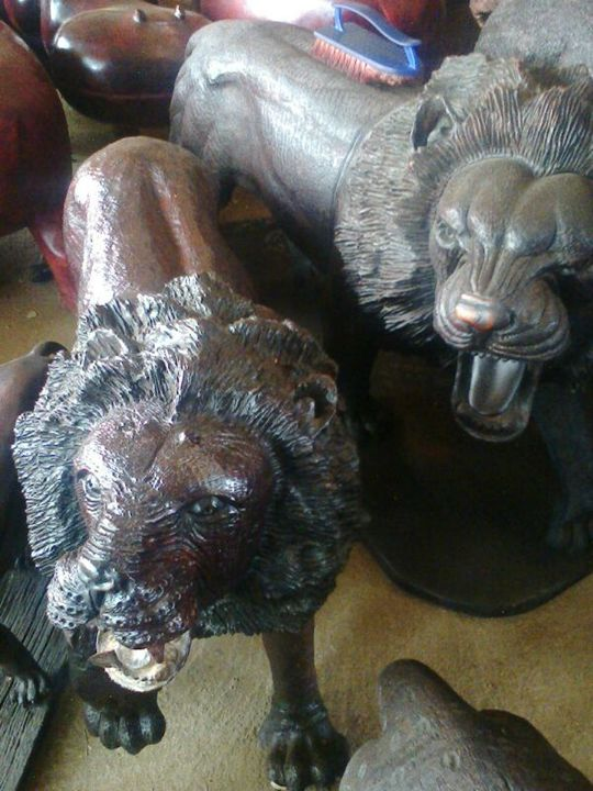 IRONWOOD LIONS $2000.00 - YADAH SCULPTURES