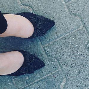 Feet in black high heels