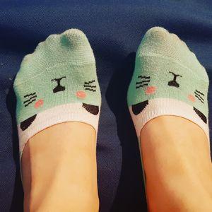 Feet with cat socks
