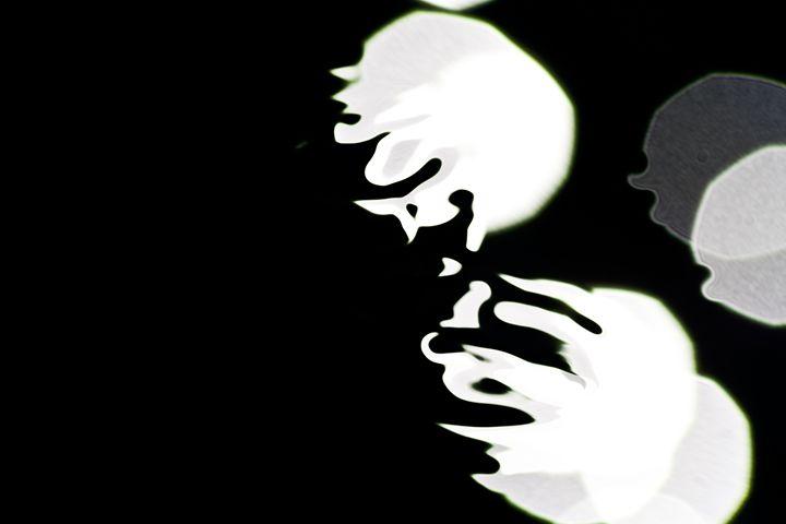 spots of light on black water - brunopaolobenedetti