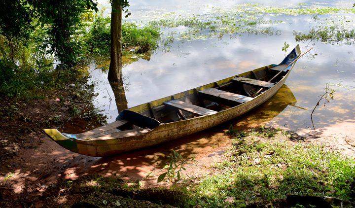 A boat on the beach  Neak Pean Lake - RCRayner