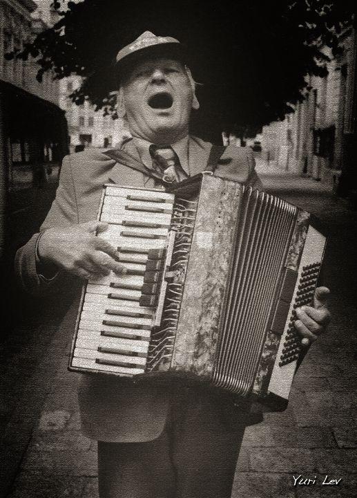 A Street Musician in Lviv Ukraine - Yuri Lev Studio