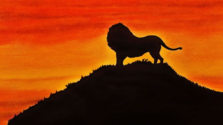 Lion on forest cliff after sunset - Amitava0112