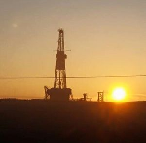 Oil rig in North Dakota at sunrise