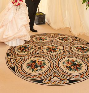 Mosaic entrance with bride and groom