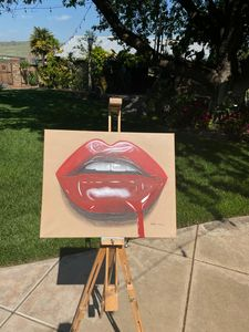 Red glossy dripping lips