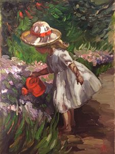 A girl watering flowers