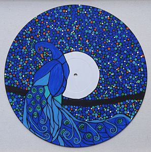 Peacock on vinyl record