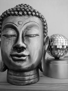 Buddha head with disco ball