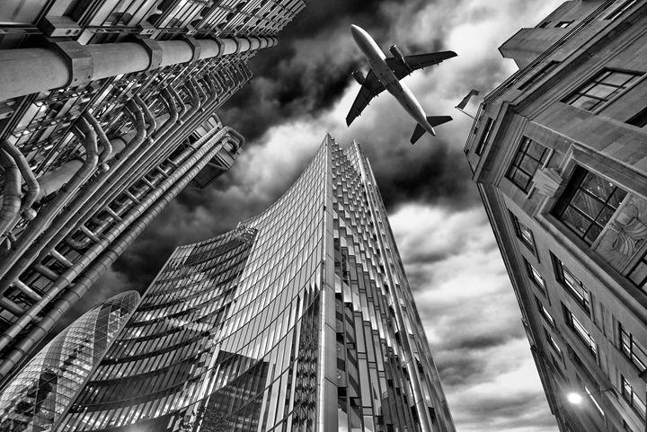 A jet plane flying over the city - pbombaert