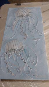 White jellyfish on blue canvas