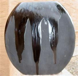 Black on black vase.