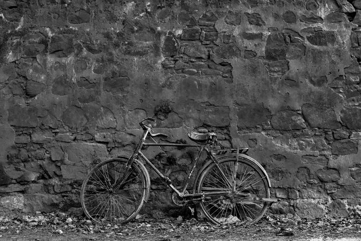 bicycle leaning on a old  brick wall - KOBAYASHI photography
