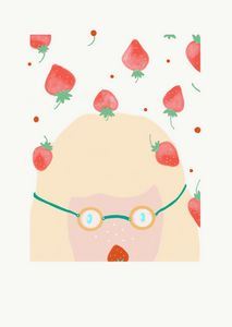A girl in glasses with strawberries