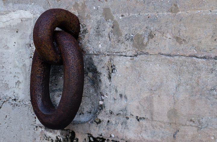 Chain Link Concrete Wall - David J Riffey